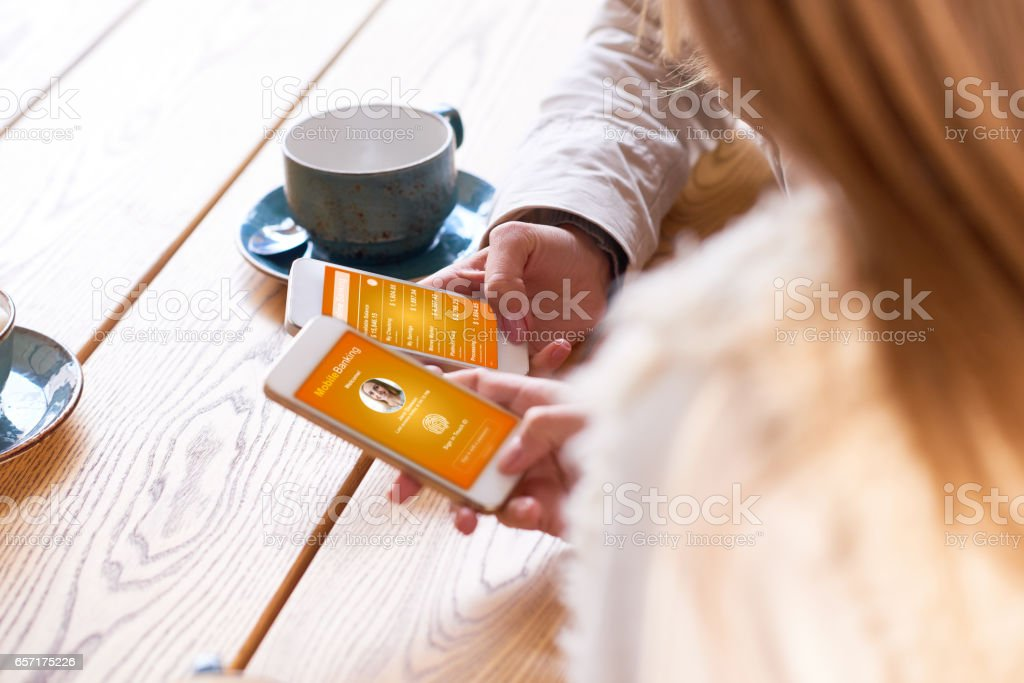 Saving time and money with mobile banking app stock photo