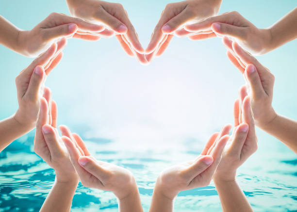 saving water and world water day for csr campaign concept with collaborative hands in love heart shape - sorte foto e immagini stock