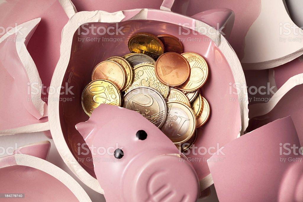 Savings. Broken piggy bank with euro coins royalty-free stock photo