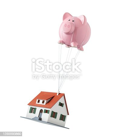 Increase the value of your home. House lifted by piggy bank hot air balloon  isolated on white background. Concept photo.