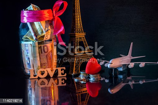 Savings for travel to Paris and toy eiffel tower