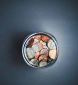 istock Savings jar filled with cash 831001626