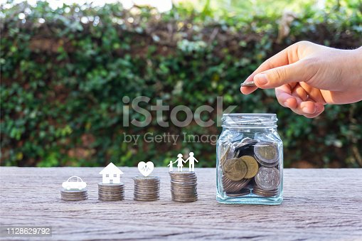 istock Savings money for family life concepts. 1128629792