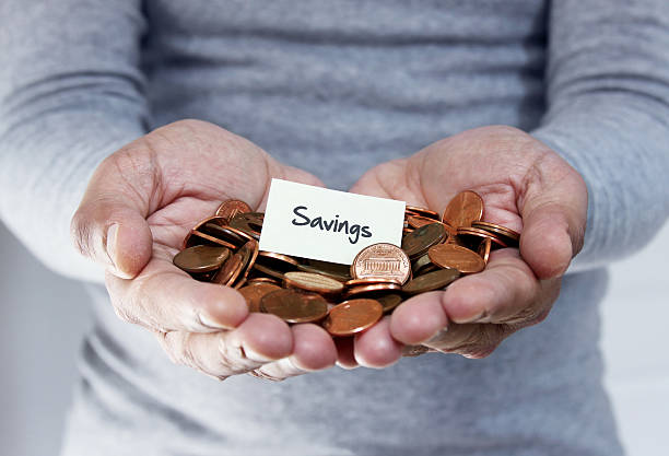Savings plan with loose coins stock photo