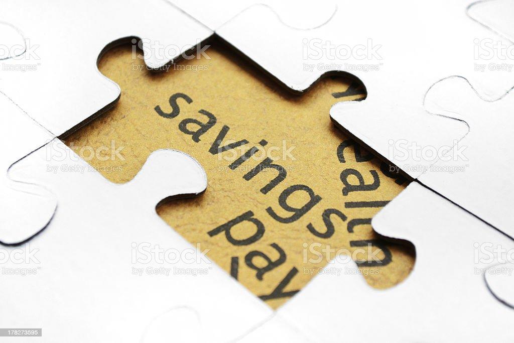 Savings puzzle concept stock photo