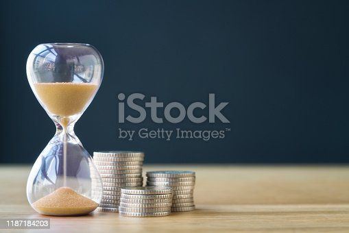 Time and stack of coins.