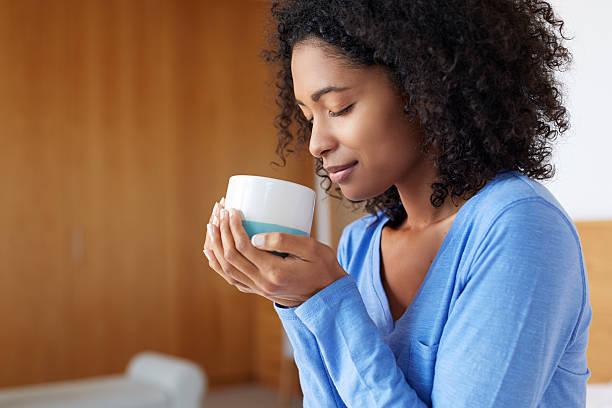 Savoring her morning coffee stock photo