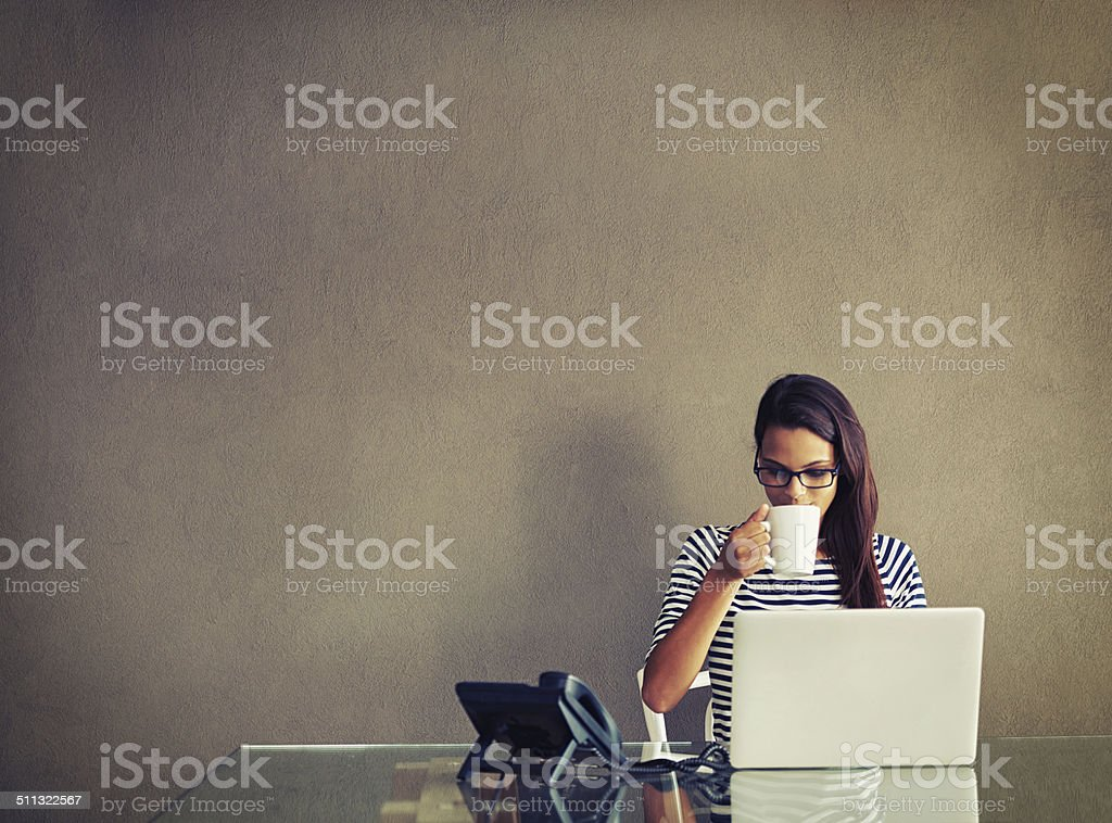 Savoring her morning coffee stock photo