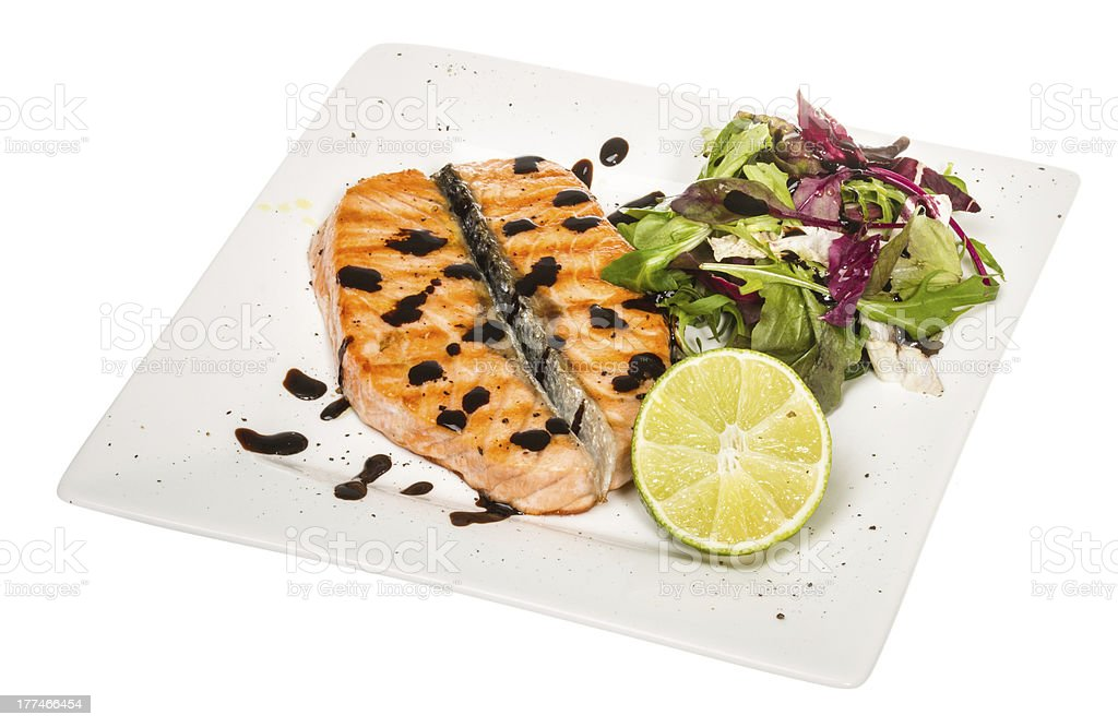 savory fish portion : roasted norwegian salmon fillet garnished royalty-free stock photo
