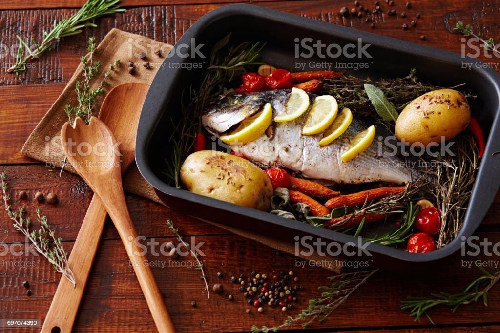 Savory fish with vegetables stock photo