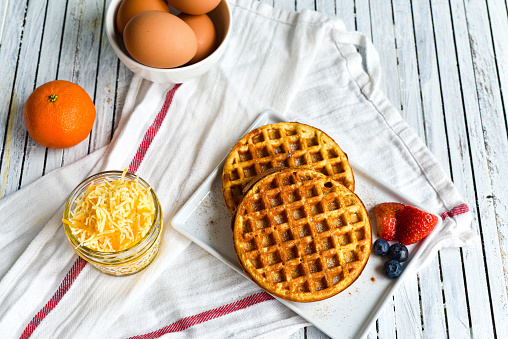 Egg and cheese waffles (Chaffles) on a wooden table