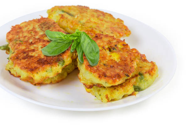 Savory rice fritters with vegetables on dish close-up stock photo