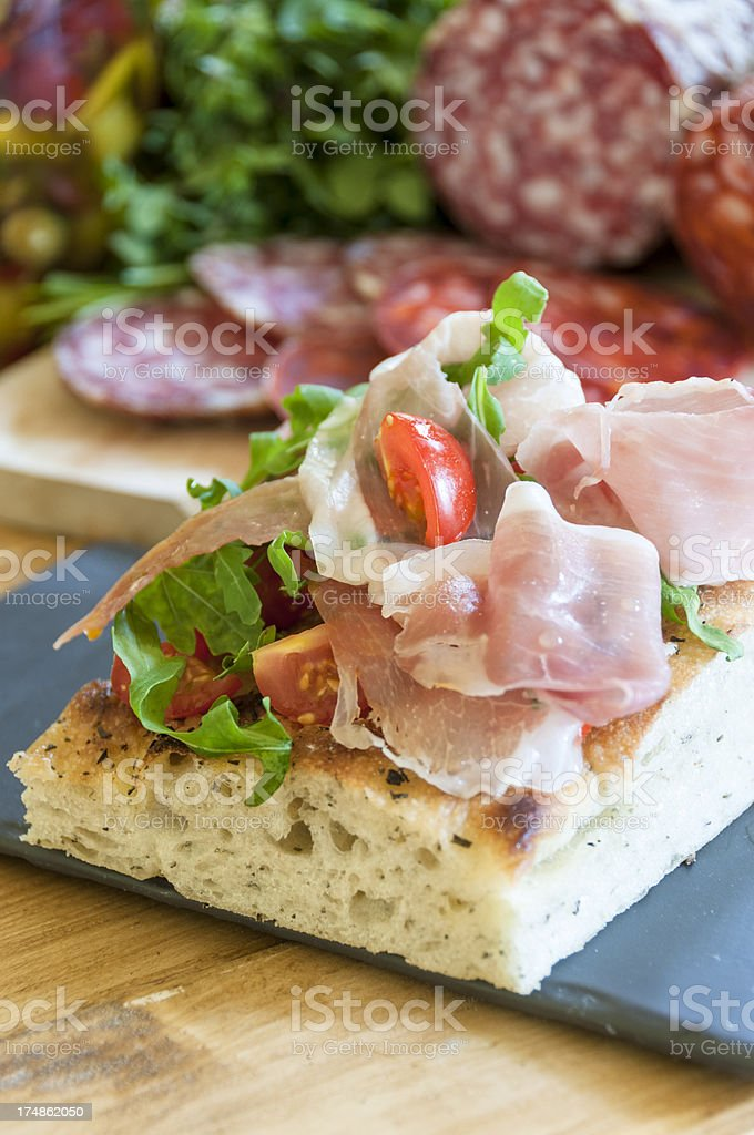 Savoury Slice With Ham, Tomato And Rocket royalty-free stock photo