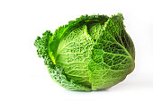 Savoy cabbage (Brassica oleracea L. convar, capitata var., Sabauda), isolated on white background. Slows the growth of malignant tumors. Add to your diet. Selective focus, copy space.