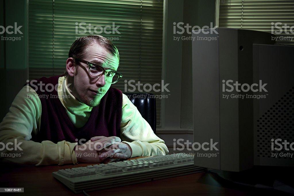 Savvy Tech Man In Dark Office stock photo
