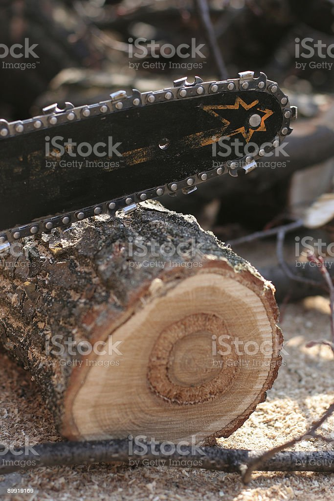 Saw and sawdust royalty-free stock photo