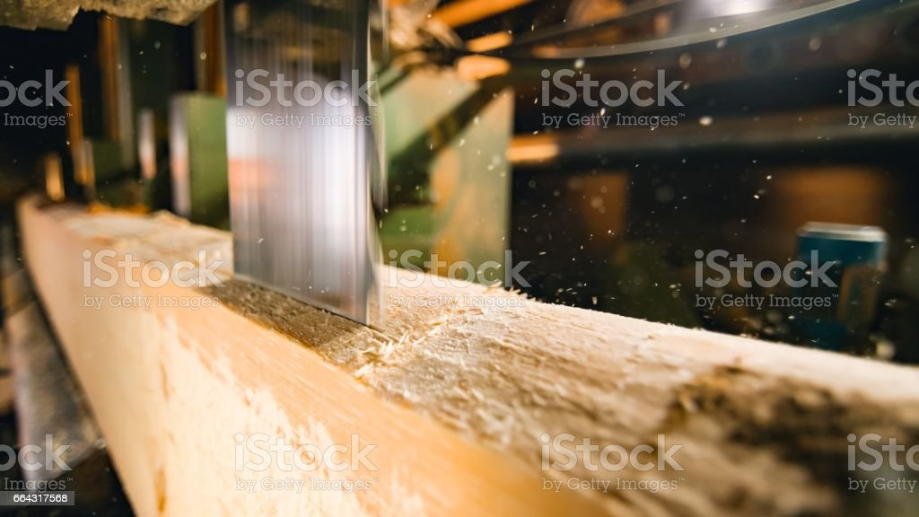 Saw cutting a log stock photo