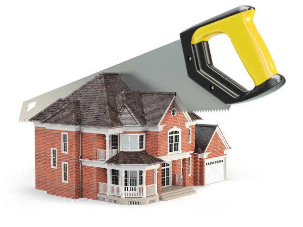 Saw is splitting a house isolated on white background.  Divorce and dividing a property concept. stock photo