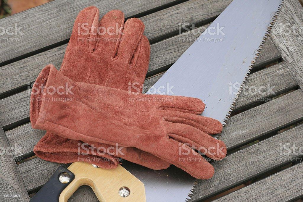 saw work gloves royalty-free stock photo
