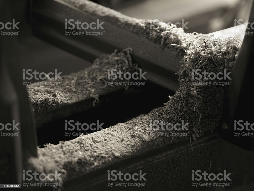 Sawdust on an Old Table Saw stock photo