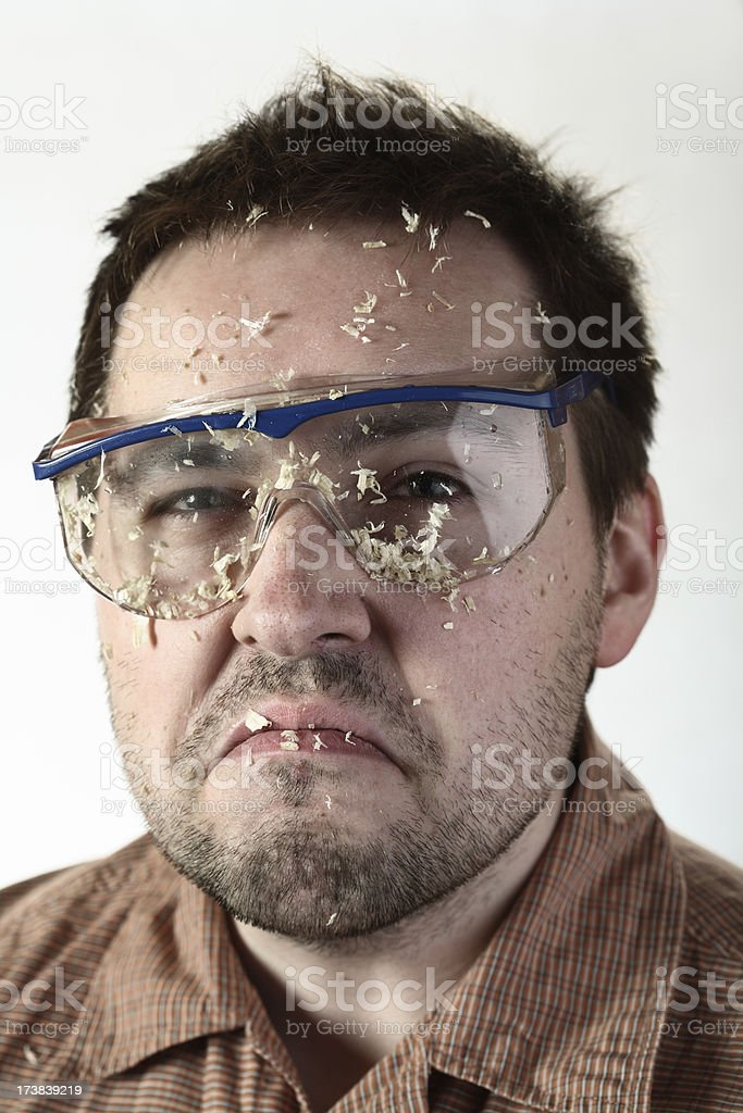 Sawdust on face and goggles. royalty-free stock photo