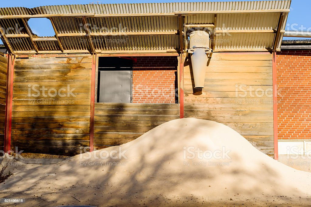 Sawdust outlet and pile foto stock royalty-free