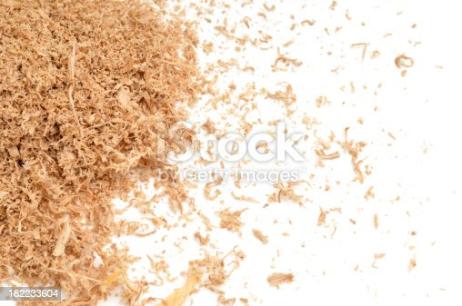 Oak Sawdust scattered over a white background.