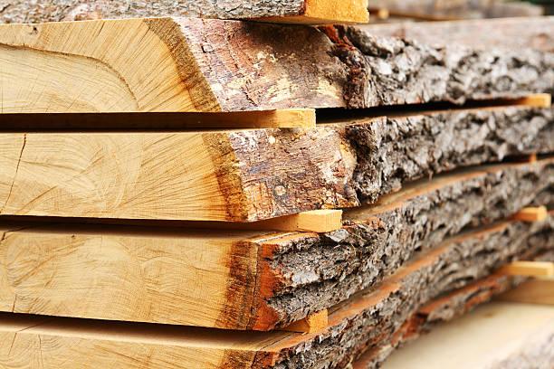 Sawed oak tree trunk plank being dried stock photo
