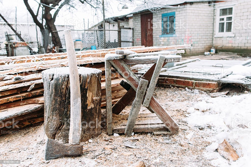 Sawhorse in winter yard. Russian snow stock photo