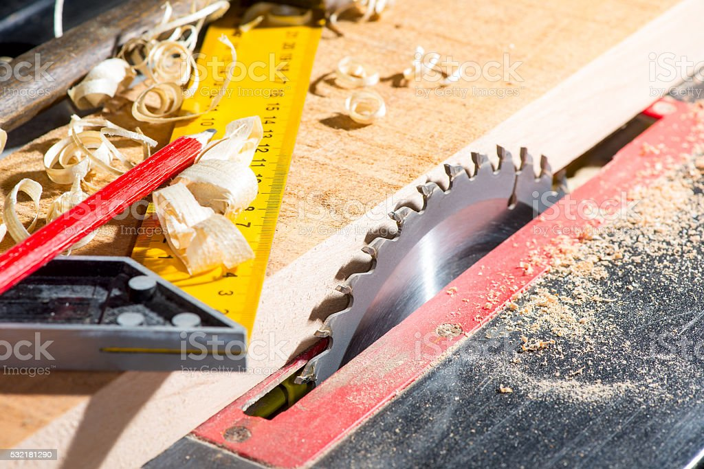 sawing board by a circular saw stock photo
