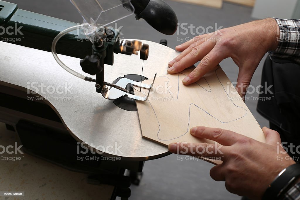 Sawing jigsaw Plywood stock photo