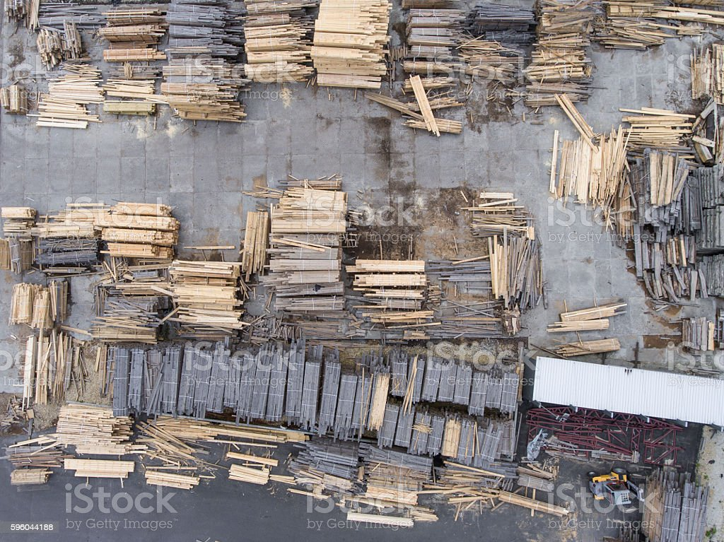 Sawmill. Felled trees, logs stacked in a pile. royalty-free stock photo