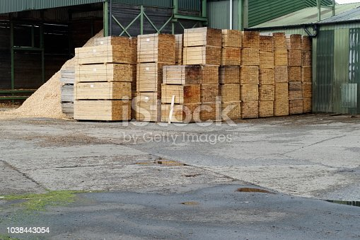 istock Sawmill stacked wood planks pallets at factory outdoors 1038443054