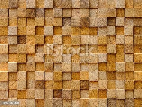 Sawn teak wood section square trimmed lengths stacked on a shelf, for sale, in a timber yard, background.