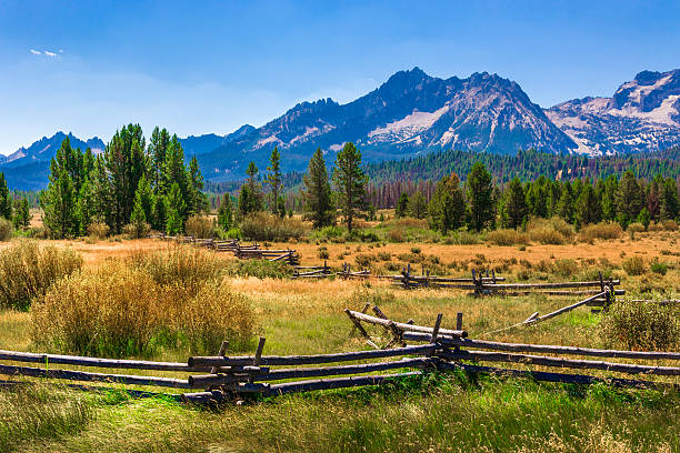 Sawtooth Mountains, ranch land, rail fence, Stanley, Idaho (ID) stock photo
