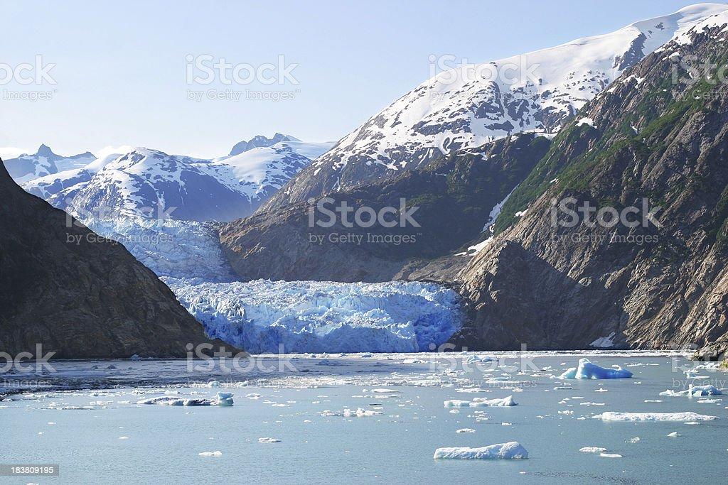 Sawyer glacier in Alaska mountains stock photo