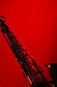 Sax performing at the nightclub show. Saxophone musical instrument colorful concept.