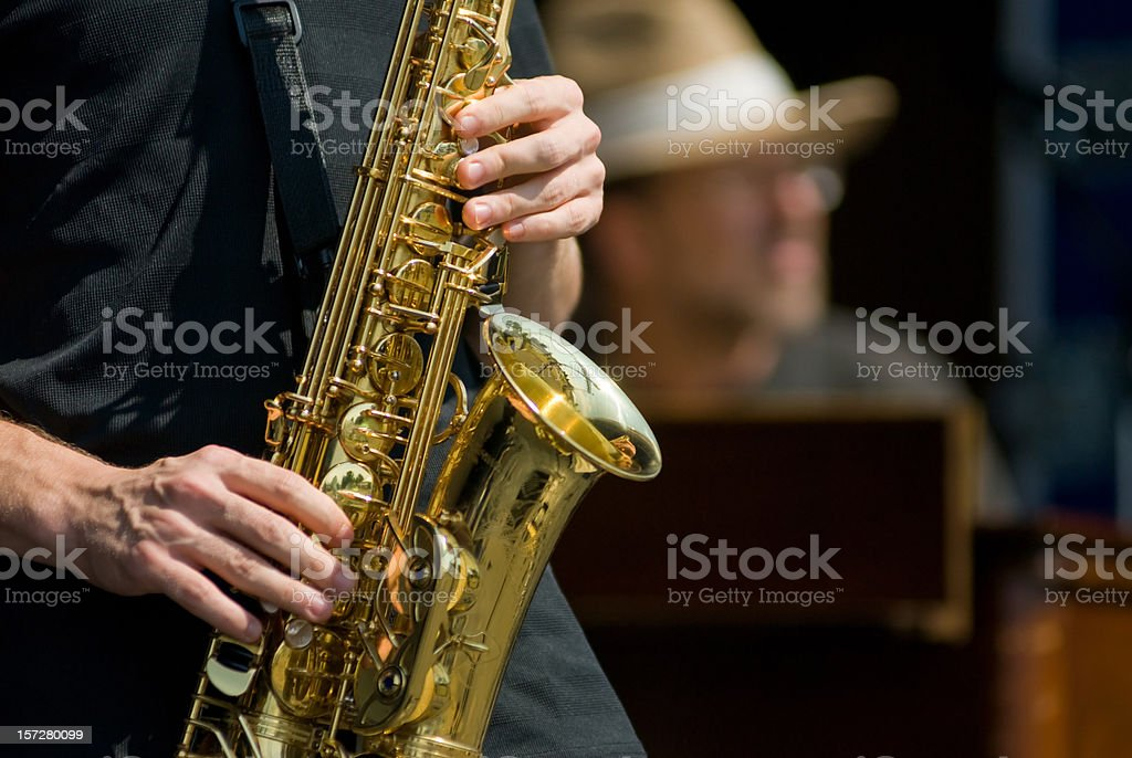 Sax Player and Keyboardist Focus is on the sax. Big Band Stock Photo
