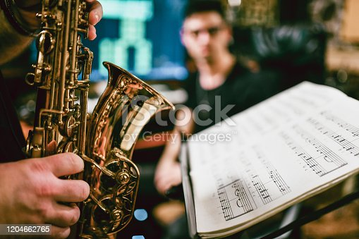 Sax Player Playing His Parts Written In Sheet Music