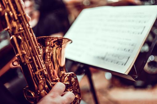 Sax Player Reading Sheet Music