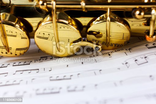 Sax Soprano with musical notes reflected