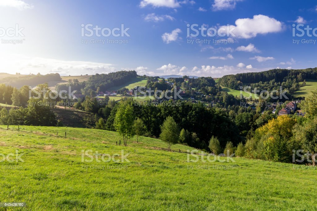 Saxon Switzerland (Bohemian Switzerland or Ceske Svycarsko) meadow and village on a sunny day in summer stock photo