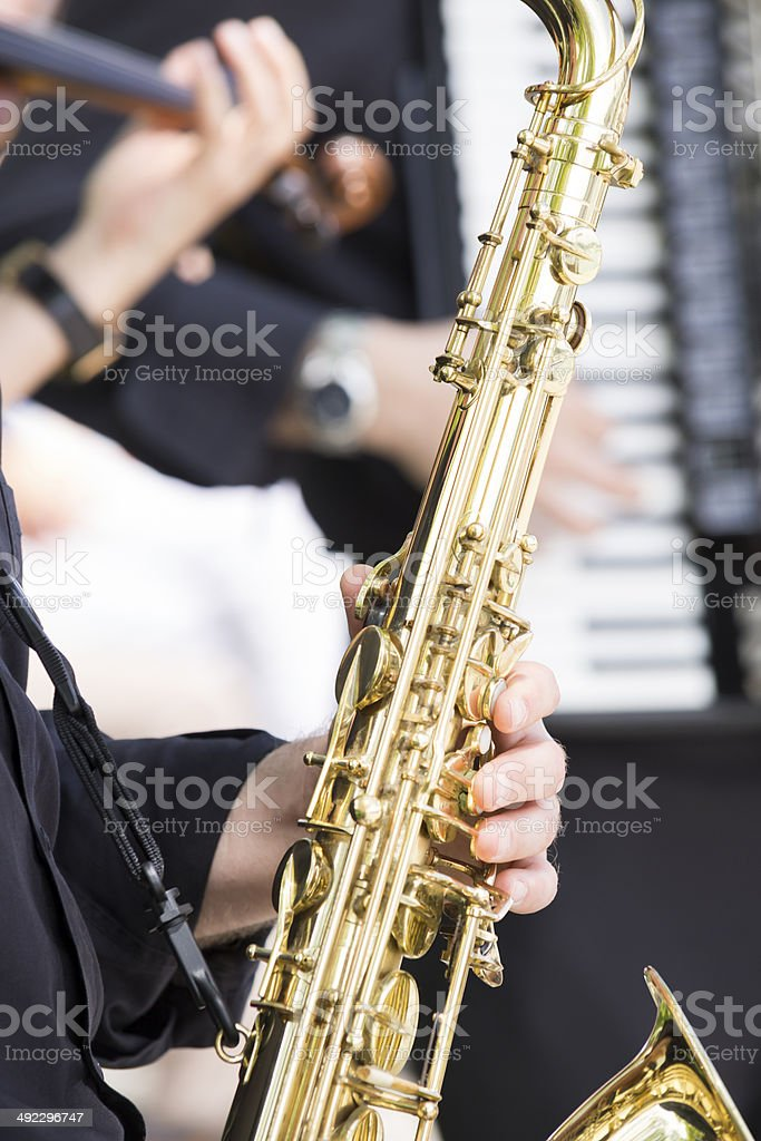 Saxophone, accordion and fiddle stock photo