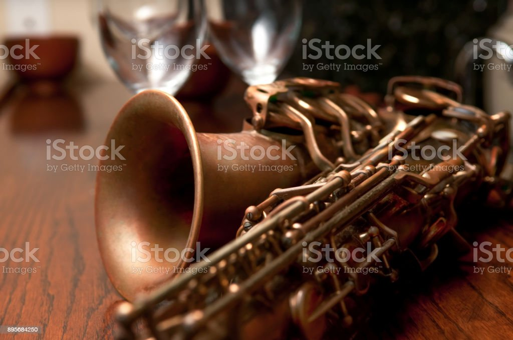 Saxophone an Glasses on a Bar stock photo