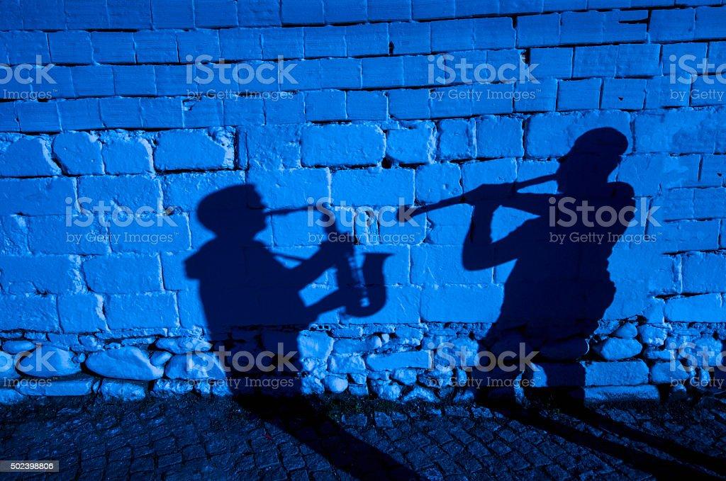 Saxophone and clarinet shadow. stock photo