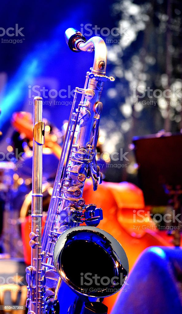 saxophone and flute on stage stock photo