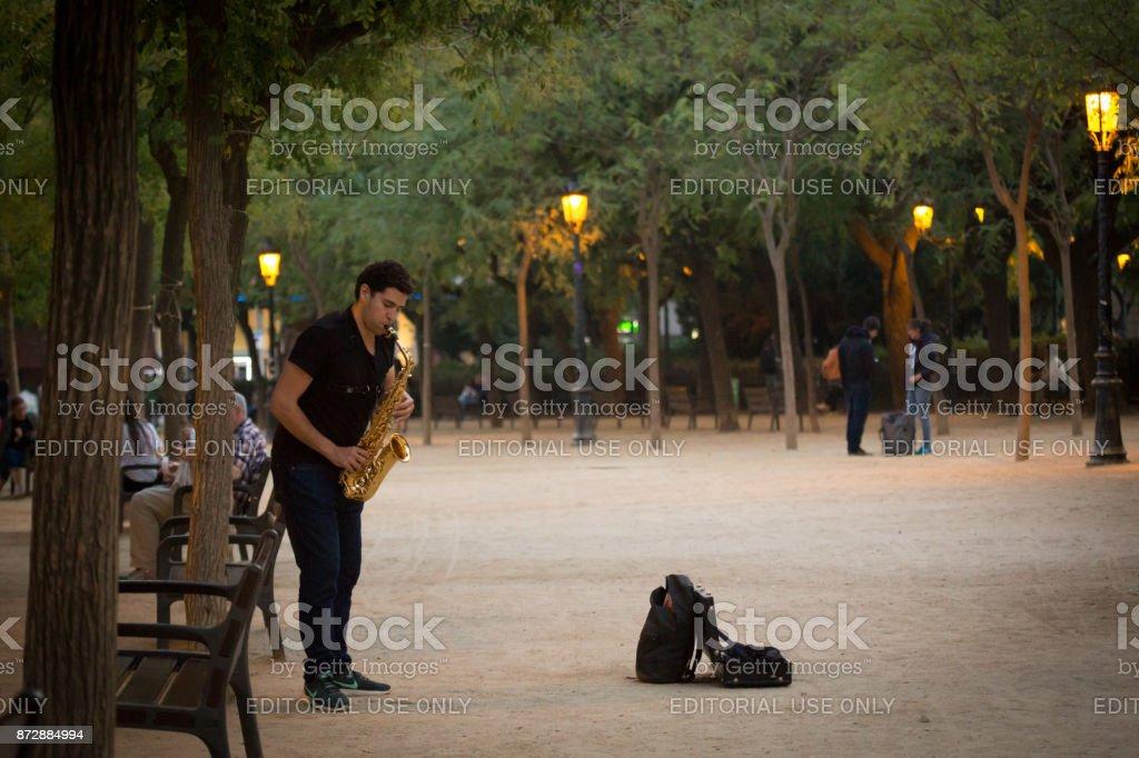 Saxophone Busker in Park stock photo