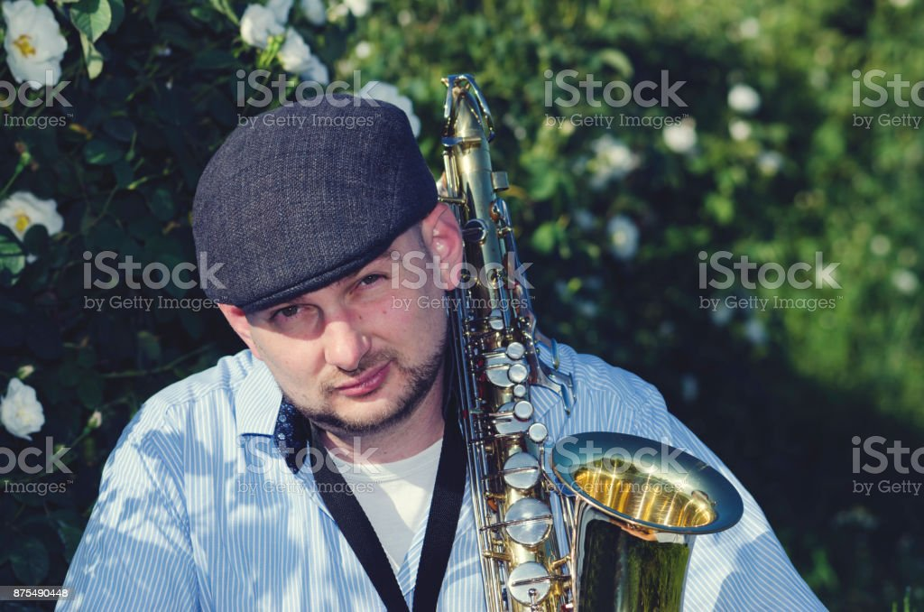 Saxophone Musician Performance Roses stock photo
