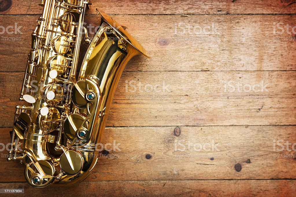Saxophone on wood stock photo