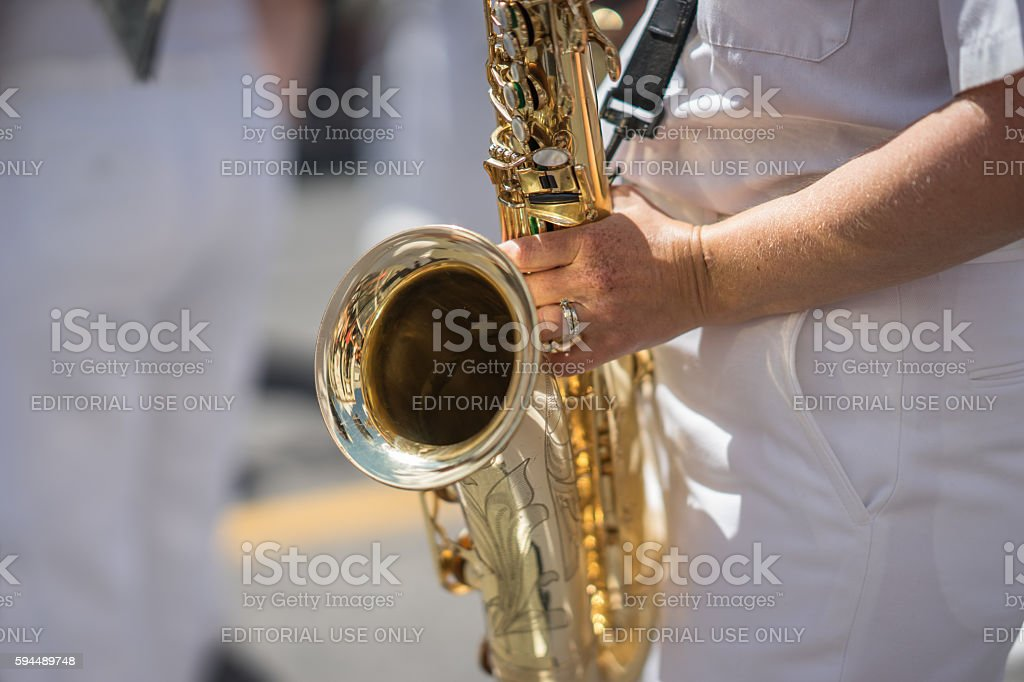 Saxophone player in a military or marching band stock photo